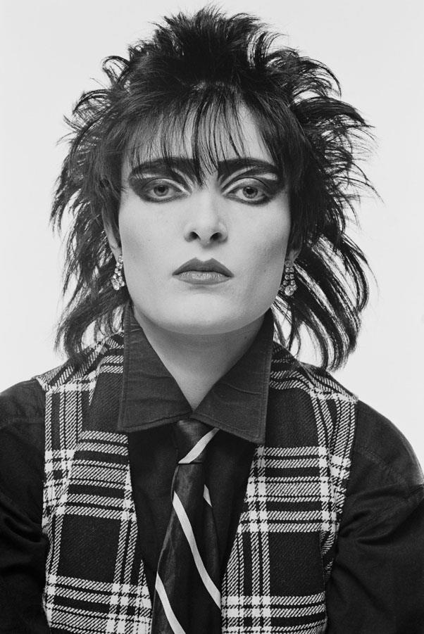 <strong>1979: SPIKY PUNK HAIR</strong> <br><br> Musician Siouxsie Sioux and her goth-meets-punk style brought wispy, all-over-the-place hair into popularity.