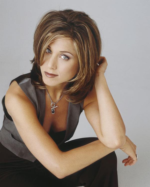 """<strong>1994: THE RACHEL</strong> <br><br> By now, we all know that Jennifer Aniston secretly hated the style that launched a thousand (or a million) haircuts: """"The Rachel."""" Still, it's impossible not to feel nostalgic over the Friends star's famous cut."""