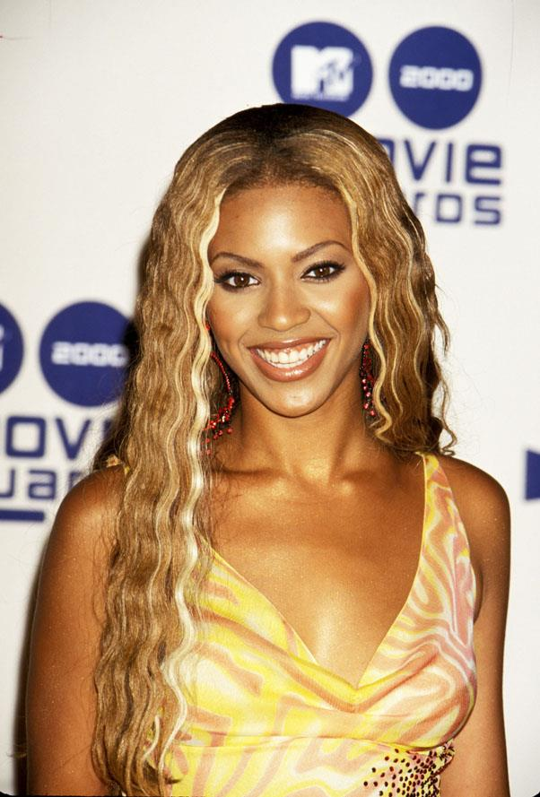 <strong>2000: FACE-FRAMING HIGHLIGHTS</strong> <br><br> Leaving behind the crazier styles of the '90s, the 2000s started to see more wearable colors and cuts like Beyonce's wavy, honey blonde hair.