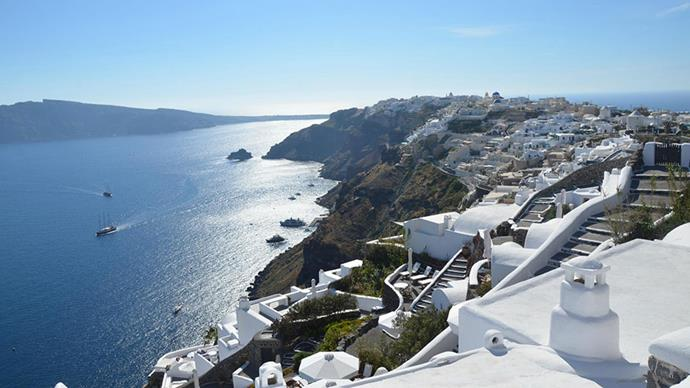<strong>2. Santorini, Greece</strong> <br><br> <strong>What to do:</strong> Wander by the traditional white painted houses, visit the white, red and black sand beaches, and take in views of the island's dormant volcano.