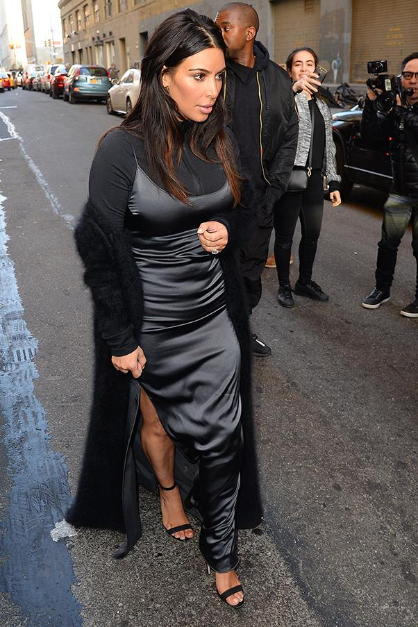 Kim (questionably) teamed a navy slip with an Adidas zip-up jacket in New York, April 2016