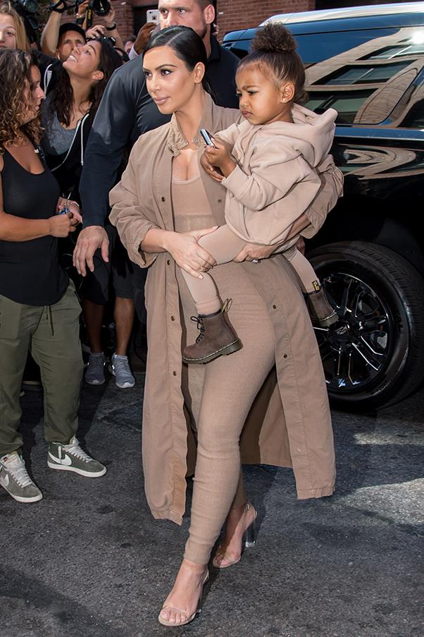 With daughter North at the launch of Yeezy Season 2 at New York fashion week, September 2015