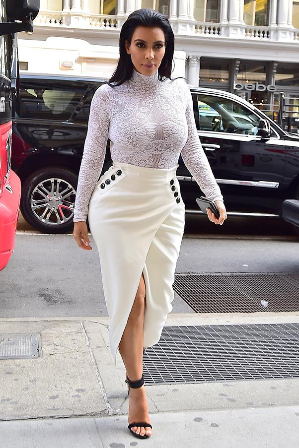 Kim pairs white with cream in Soho, May 2015