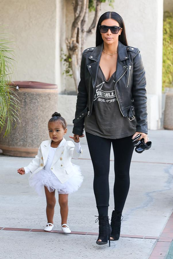 Taking daughter North to a ballet class (in a custom Balmain mini-jacket), May 2015