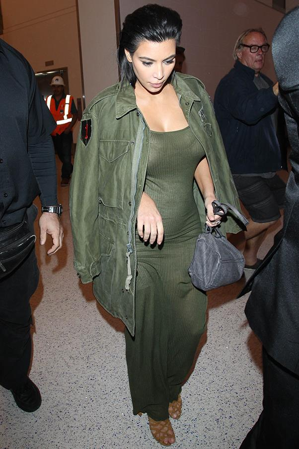 Head-to-toe khaki and showing off her growing baby bump at LAX, June 2015