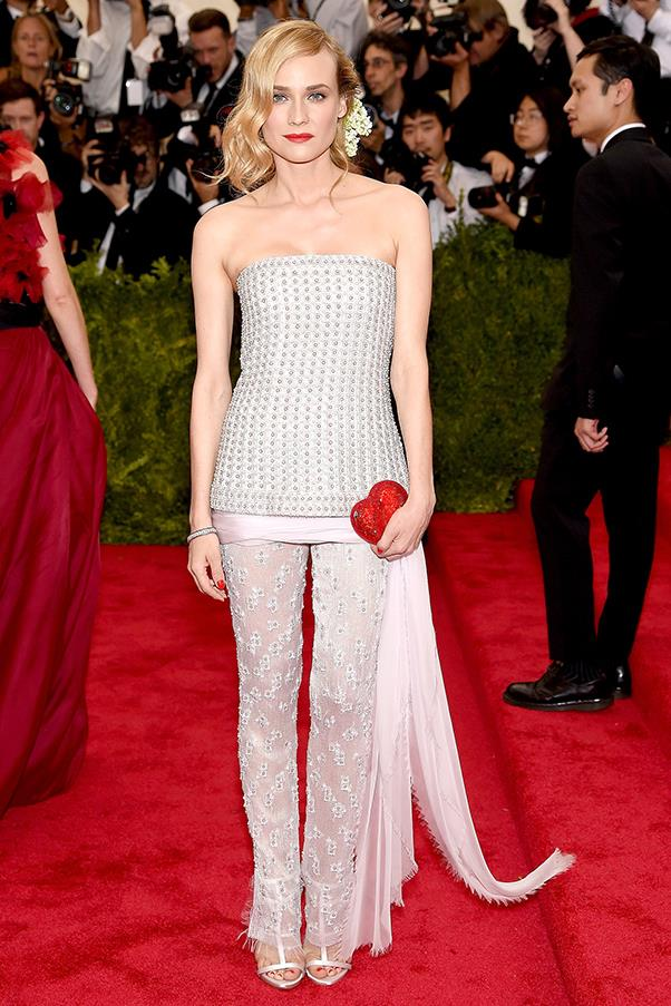 """<strong>Diane Kruger in Chanel, 2015</strong><br><br> """"I feel like if someone were to describe what's going on here (bejewelled pants, a heart-shaped purse, some sort of weird sash thing) it would sound horrific, but such is the aesthetic acumen of Diane Kruger — especially when teamed with Chanel — that the look is utter perfection. Damn her (and those oddly alluring satin gladiator sandals)."""" - <em>Jessica Matthews, deputy chief subeditor</em><br><br> """"Chanel + Diane Kruger + The Met Ball = can't go wrong. I love that Kruger steered clear of the expected. This tunic over pant ensemble still feels black tie, which is no mean feat."""" - <em>Alison Izzo, digital editor</em>"""
