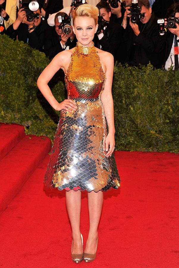 """<strong>Carey Mulligan in Prada, 2012</strong><br><br> """"Carey Mulligan in this gilded, armour-like metallic Prada frock is both fierce but also refreshingly youthful. I love that she didn't need a full-blown gown to make a statement."""" - <em>Alison Izzo, digital editor</em>"""