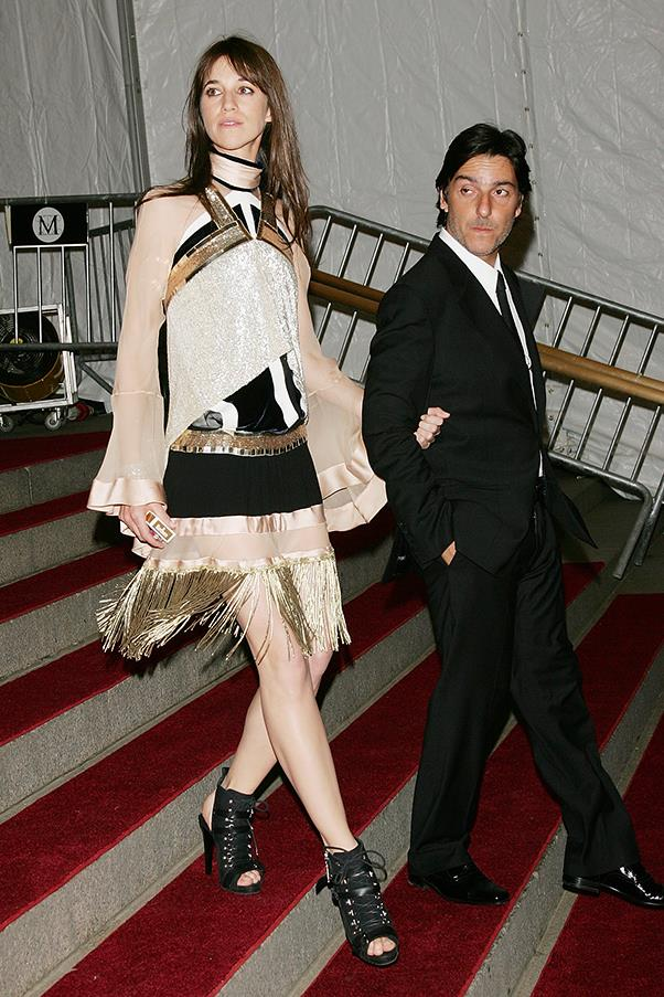 """<strong>Charlotte Gainsbourg in Balenciaga</strong><br><br> """"Charlotte Gainsborough + Nicholas Ghesquiere Balenciaga = my heaven. I love the gold embellishment detail and sheer panels on this mini dress. It's still impressive without being a long gown."""" - <em>Caroline Tran, market editor</em>"""