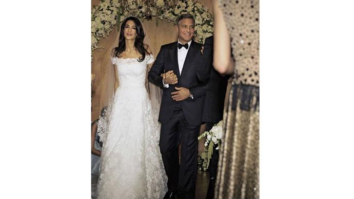 """<strong>Amal Alamuddin and George Clooney</strong> <br><br> <strong>The dress:</strong>Oscar de la Renta <br><br> <strong>The food:</strong> Guests were treated to a five -course meal created by Riccardo de Pra. <br><br> <a href=""""https://www.instagram.com/p/8ykEQBvOkT/"""">@amalclooney</a>"""