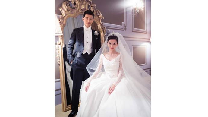 """<strong>Angela Yeug and Huang Xiaoming</strong> <br><br> <strong>When: </strong> October 8, 2015 <br><br> <strong>Where:</strong>The Shanghai Exhibition Centre <br><br> <strong>Cost: </strong>$40 million approx <br><br> <a href=""""https://www.instagram.com/p/8z5qJTpuyg/"""">@dior</a>"""