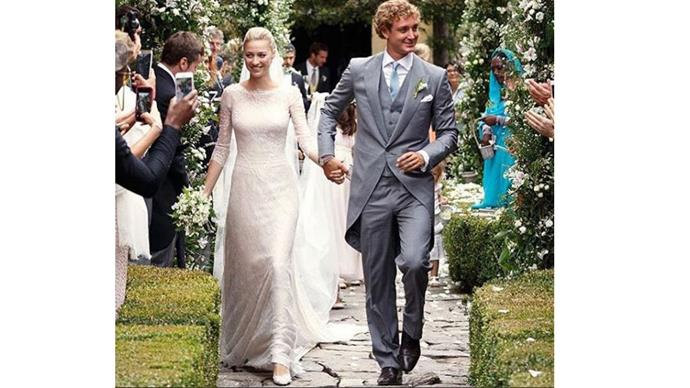 <strong>Beatrice Borromeo and Pierre Casiraghi</strong> <br><br> <strong>The dress:</strong> For the service the bride wore a custom ivory Giorgio Armani Privé gown and a long veil.