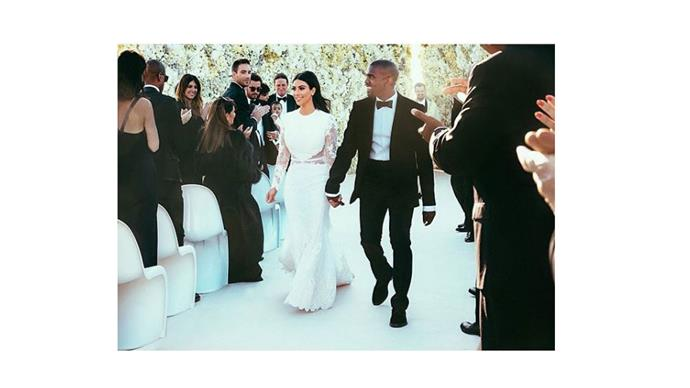 """<strong>Kim Kardashian and Kanye West</strong> <br><br> <strong>The Entertainment:</strong> How do you continue to impress after a pre-wedding performance by Lana Del Rey in Paris? With John Legend and Andrea Boccelli, of course. <br><br> <a href=""""https://www.instagram.com/p/ogRbymuS8J/"""">@kimkardashian</a>"""