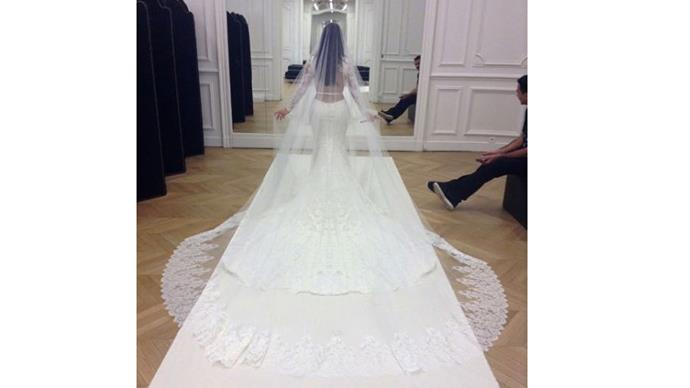 """<strong>Kim Kardashian and Kanye West</strong> <br><br> <strong>The dress: </strong>Kim wore Givenchy haute couture for the ceremony and her signature - Balmain - for the reception. <br><br> <a href=""""https://www.instagram.com/p/o7D-1zOS0C/"""">@kimkardashian</a>"""