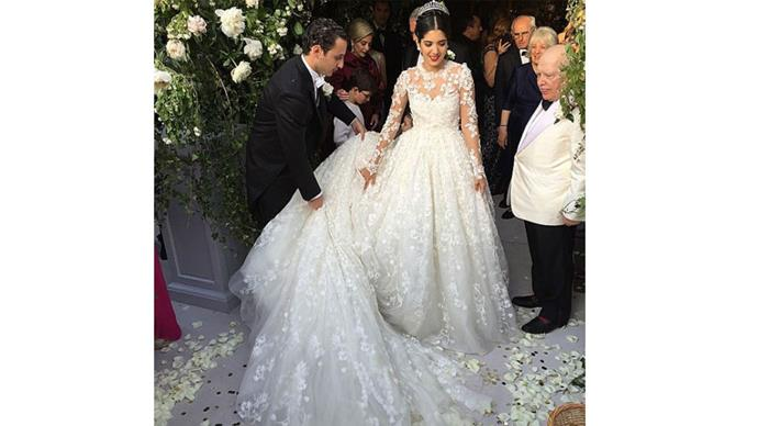 """<strong>Noor Fares and Alexandre Al Khawam</strong> <br><br> <strong>When:</strong> July 13, 2015 <br><br> <strong>Where:</strong> L'Eglise Sainte Catherine, Normandy, France. <br><br> <strong>Cost:</strong> It has been estimated that the wedding cost upwards of $14 million. <br><br> <a href=""""https://www.instagram.com/p/34S6WARt6h/"""">@naseebs </a>"""