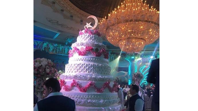 <strong>Khadija Uzhakhovs and Said Gutseriev</strong> <br><br> <strong>The cake:</strong>The towering and ornately decorated wedding cake didn't fail to bring the drama either.