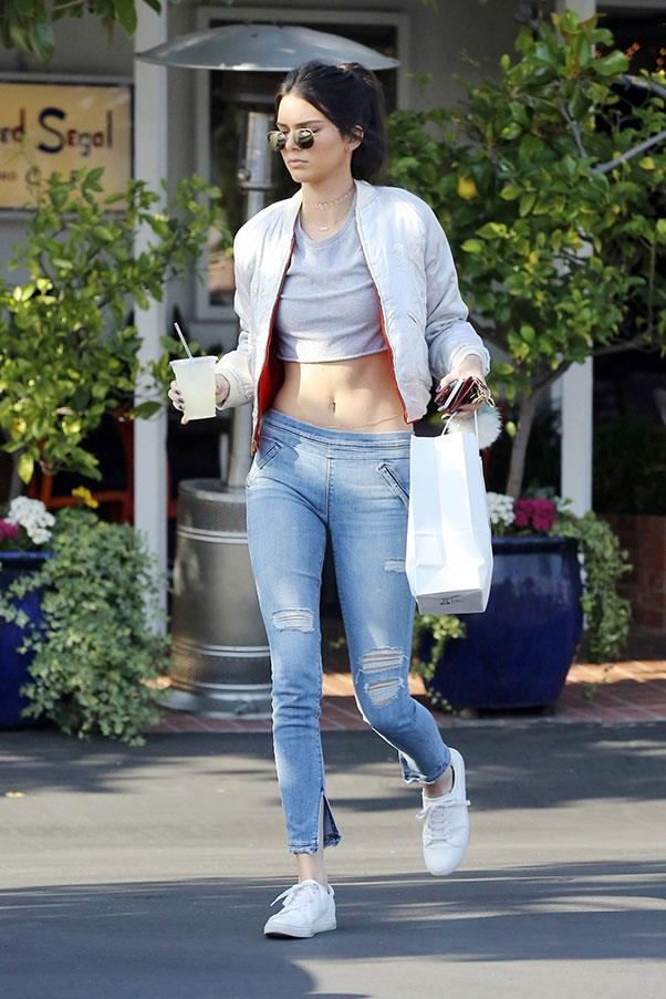 <strong>April 26th, 2016</strong> <br><br> The model took to the streets her signature style of crop top, distressed denim and Kenneth Cole kicks.
