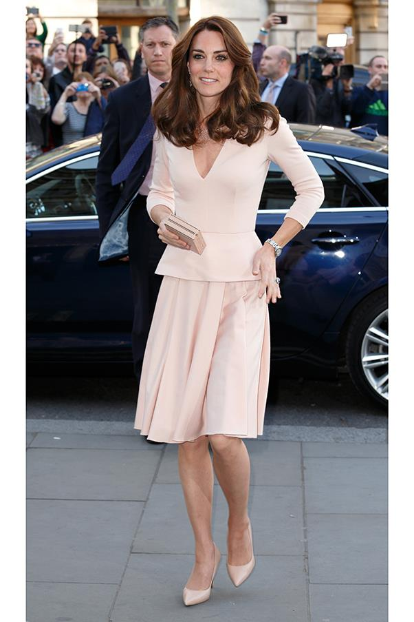Kate appears glamorous and pretty in a pale pink Alexander McQueen ensemble, as she steps out in London