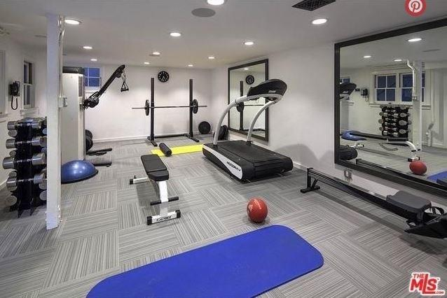 """Their own private gym. <br><br> Image: <a href=""""http://guests.themls.com/Details/CA/LOS-ANGELES/655-MACCULLOCH-DR/90049/16-979675.aspx"""">theMLS.com</a>"""