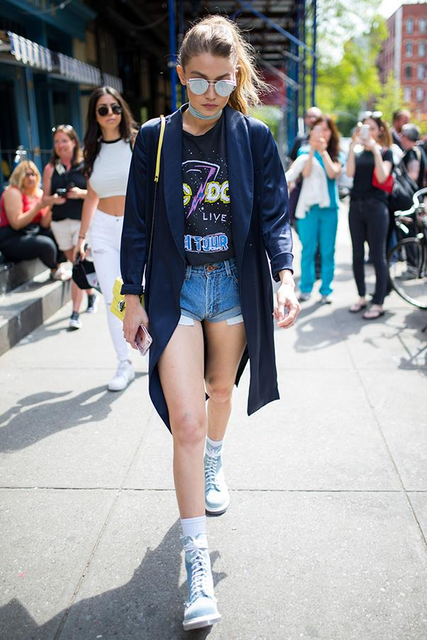 Gigi rocked a pair of One Teaspoon 'Bandits' shorts with a graphic tee and satin blazer while out to lunch in New York.