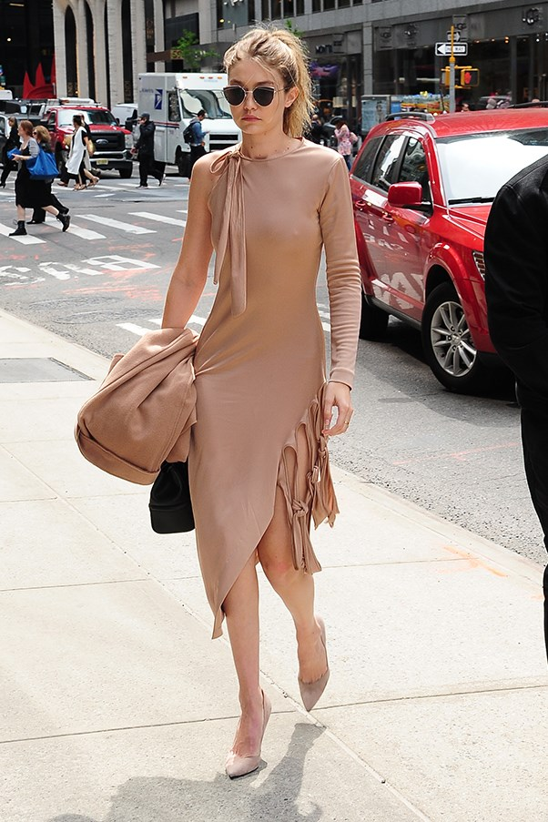 Gigi stepped out in a risque Jonathan Simkhai dress in New York, showing off her (frankly impressive) supermodel pins.