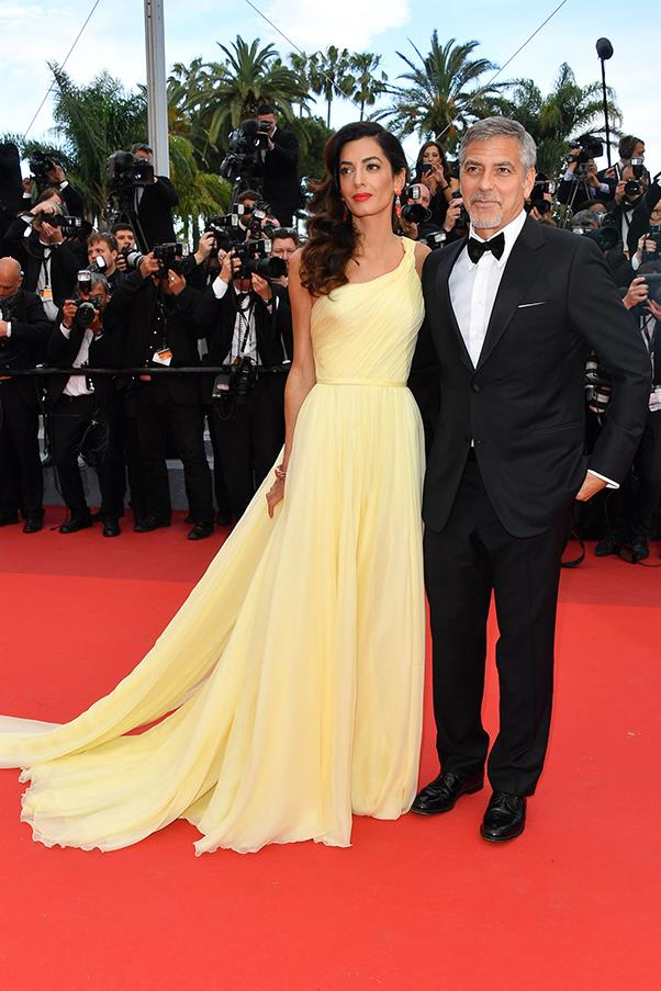 Amal Clooney in Versace and George Clooney at the premiere of <em>Money Monster</em>