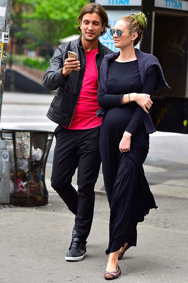 <strong>May, 2016</strong> <br><br> The model stepped out with fiancé Hermann Nicoli, looking comfortable and chic in a navy blue maxi dress, printed flats and sunnies.
