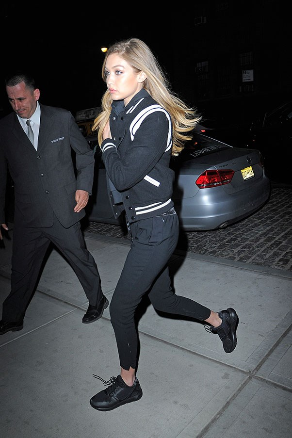 Nobody does athleisure better than Gigi, who stepped out in black pants, sneakers and a black and white varsity jacket, while out in New York.