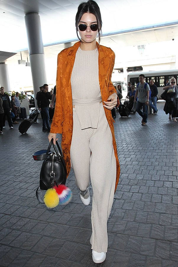 <strong>May 11th, 2016</strong> <br><br> At LAX, Kendall wore a nude matching set, a long printed burnt orange coat and rainbow fur keychains.