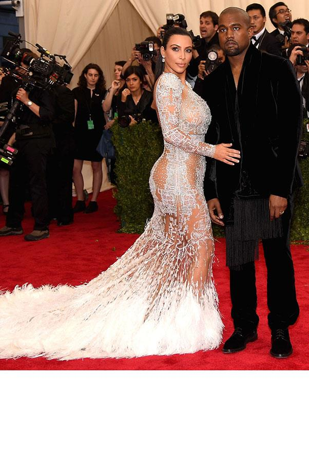 <strong>Kim Kardashian</strong> <br><br> Kim Kardashian wore a similar frock to Queen Bey at the 2015 Met Gala, hers in a white sequined and fur trimmed iteration by Roberto Cavalli.