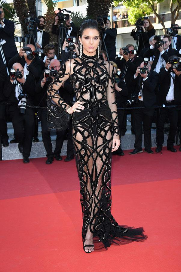 <strong>Kendall Jenner</strong> <br><br> Model-of-the-moment Kendall Jenner attended the <em>From The Land Of The Moon</em> premiere during the 69th Annual Cannes Film Festival in a dazzling black dress with cut-outs galore.
