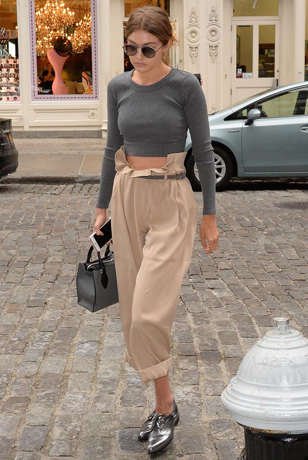 The model looked sleek in high waisted trousers, knitted crop top and metallic brogues.