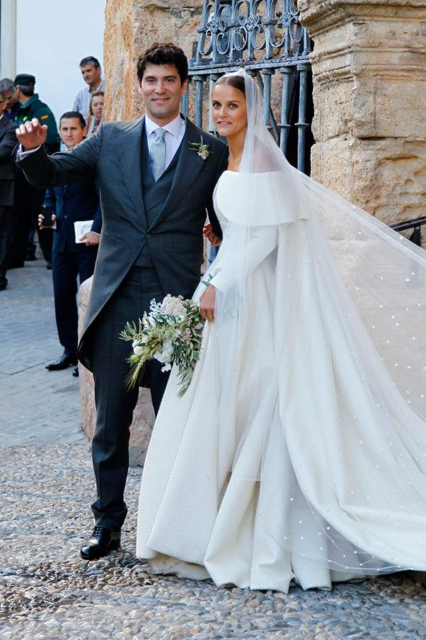 The lavish Spainish nuptials of Lady Charlotte Wellesley and Alejandro Santo Domingo may be the most stylish wedding of the year. Here, a look at the bride's custom Emilia Wickstead gown, and the chic guest list.