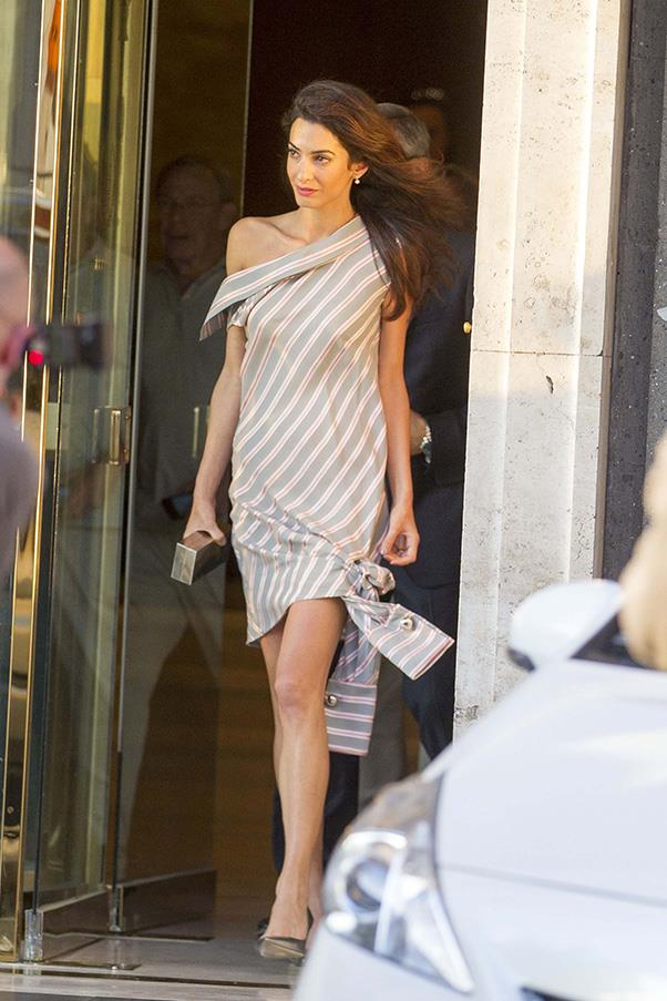 <strong>What:</strong> A one-shouldered dress by Monse with Jimmy Choo clutch and sandals<br> <strong>When</strong>: May 29, 2016<br> <strong>Where:</strong> Out to dinner in Rome with George Clooney