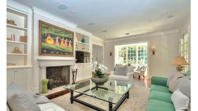A spacious living room complete with a huge fireplace.