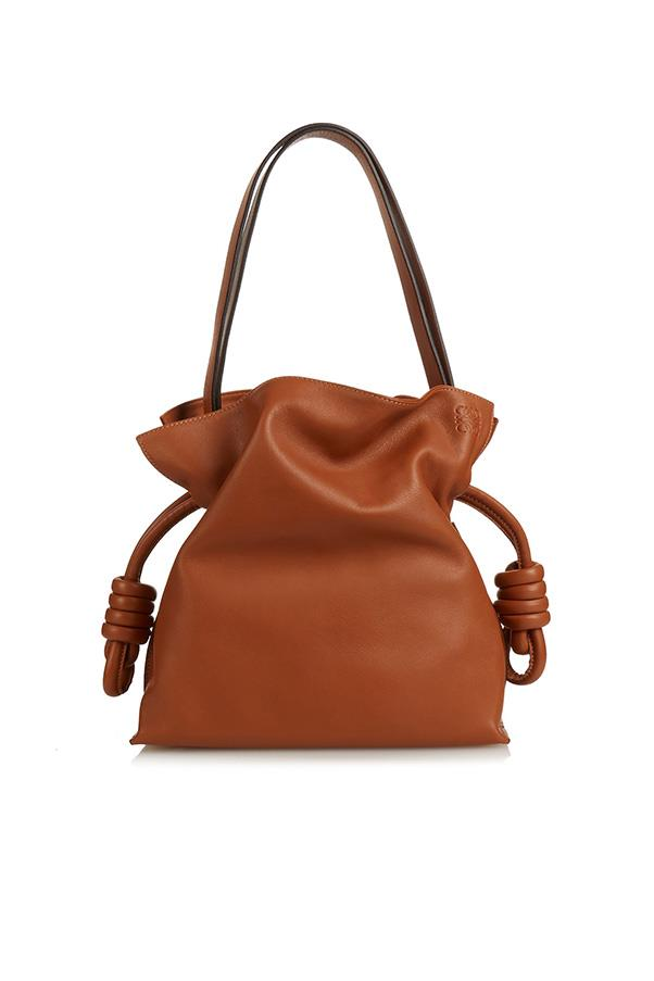 """<strong>1. A carryall tote</strong><br><br> Flamenco knot leather bag by Loewe, $2,405, <a href=""""http://www.matchesfashion.com/au/products/Loewe-Flamenco-Knot-leather-bag%09-1036000"""">Matches Fashion</a>"""