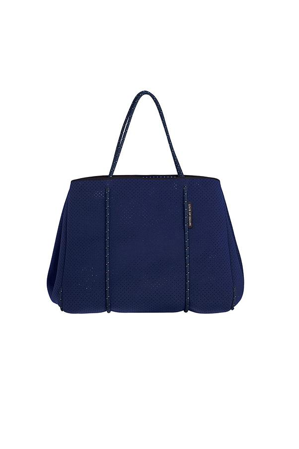 """<strong>3. A weekender bag</strong> <br><br> Escape bag in navy/royal blue by State of Escape, $299, <a href=""""https://www.modesportif.com/shop/product/escape-bag-in-navyroyal-blue/"""">Mode Sportif</a>"""