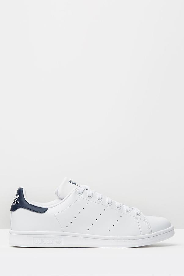 """<strong>12. A white sneaker</strong> <br><br> Running white/navy Stan Smith sneakers by Adidas, $120, <a href=""""http://www.theiconic.com.au/stan-smith-341862.html"""">The Iconic</a>"""