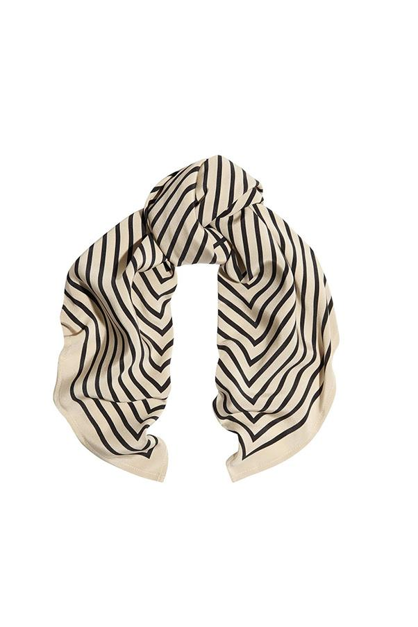 """<strong>20. A silk scarf</strong> <br><br> 'San Remo' scarf by Totême, $220, <a href=""""http://www.toteme-nyc.com/shop/ss16/san-remo-scarf?color=monogram-print&size=05"""">Totême</a>"""