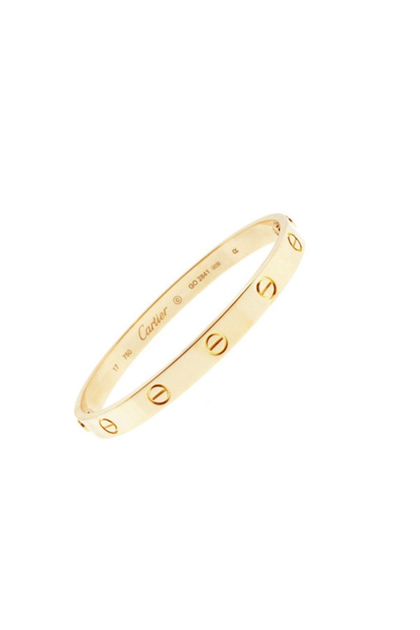 """<strong>22. A piece of fine jewellery</strong> <br><br> 'Love' bracelet by Cartier, $8800, <a href=""""http://www.au.cartier.com/en-au/collections/jewelry/collections/love/bracelets/b6035517-love-bracelet.html"""">Cartier</a>"""