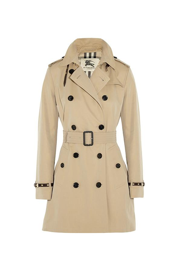 """<strong>49. A trench coat</strong> <br><br> Leather-trimmed cotton-gabardine trench coat by Burberry London, $2,915, <a href=""""https://www.net-a-porter.com/au/en/product/495946/Burberry_London/leather-trimmed-cotton-gabardine-trench-coat"""">Net-A-Porter</a>"""