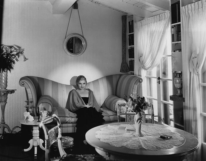 <strong>1926</strong> <br><br> Shapely sofas are all the rage in Hollywood homes, like this one belonging to Vaudeville actress Lilyan Tashman.