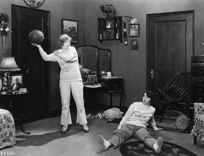 "<strong>1927</strong> <br><br> Dark wood pieces decorate the dorm room of Marion Davies in the movie ""Varsity Girl."""