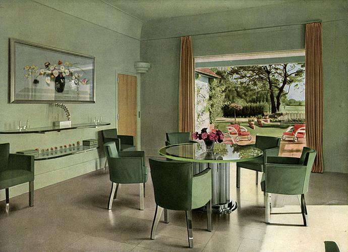 <strong>1938</strong> <br><br> In a French dining room, chrome and glass reflect the soft green walls and furnishings for a serene look.