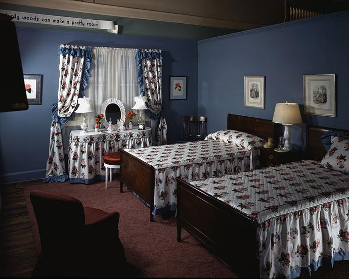 <strong>1944</strong> <br><br> Florals and frills take the edge off darker woods in this bedroom setting at Marshall Field & Co.