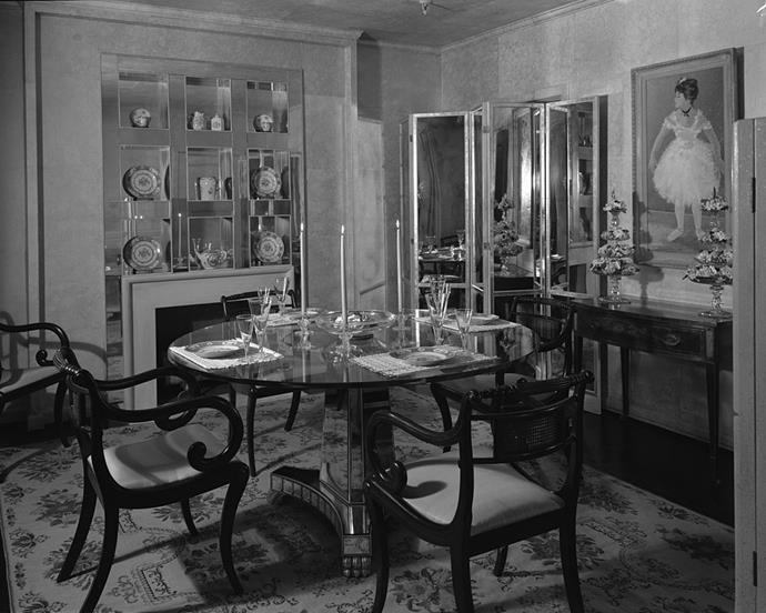 "<strong>1945</strong> <br><br> At the ""Trend House"" installation at Marshall Field & Co., a bevy of mirrors reflect an eclectic array of furniture and accessories."