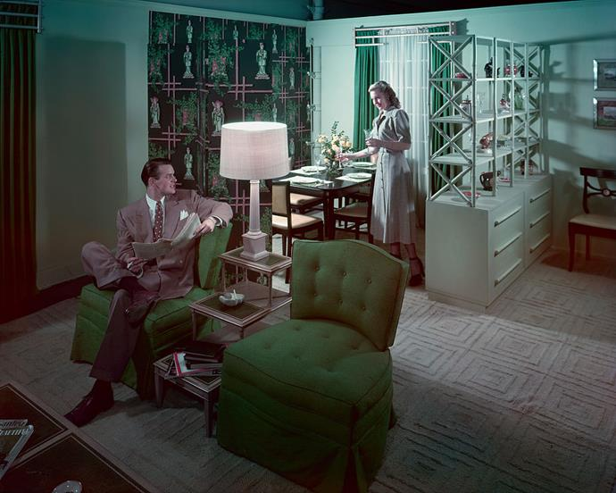 "<strong>1947</strong> <br><br> A folding screen and open shelving act as room dividers in the ""Budget House"" setting at Marshall Field & Co."