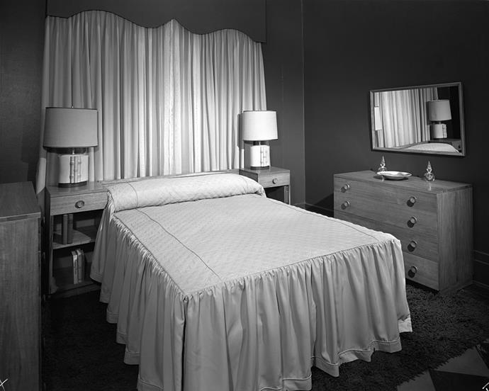 <strong>1949</strong> <br><br> A curvy valance draws the eye up in a petite bedroom setting at Marshall Field & Co.