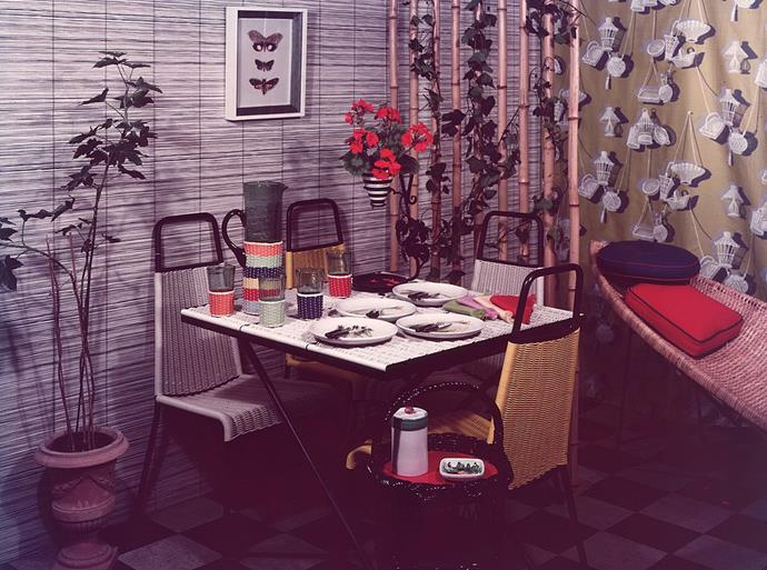<strong>1957</strong> <br><br> Woven textures bring an exotic element to this casual dining area.