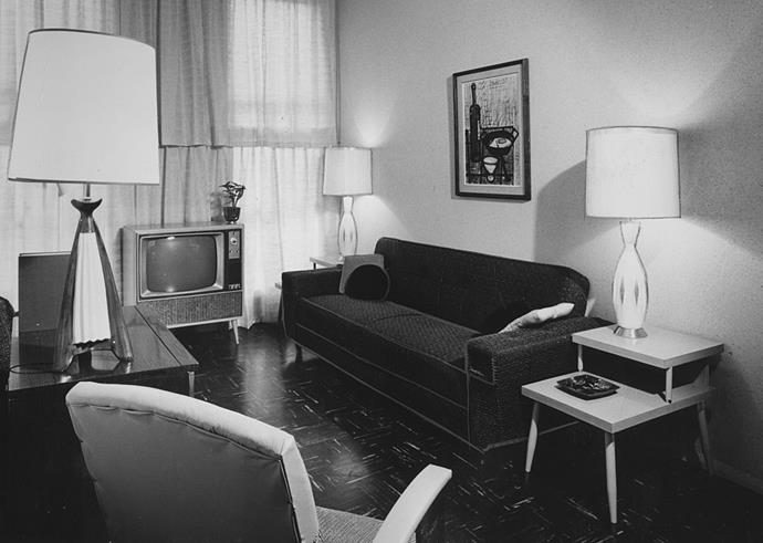 <strong>1965</strong> <br><br> A television is the centrepiece of this living room, which also features bold atomic lamps.