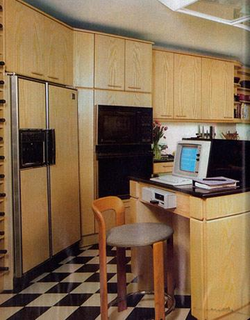 <strong>1984</strong> <br><br> However, in the '80s, we see the rise of two things: laminate and technology. This kitchen was very cutting edge at the time (though we're still not sure if working where you cook is such a great idea).